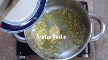 grated garlic added to pan