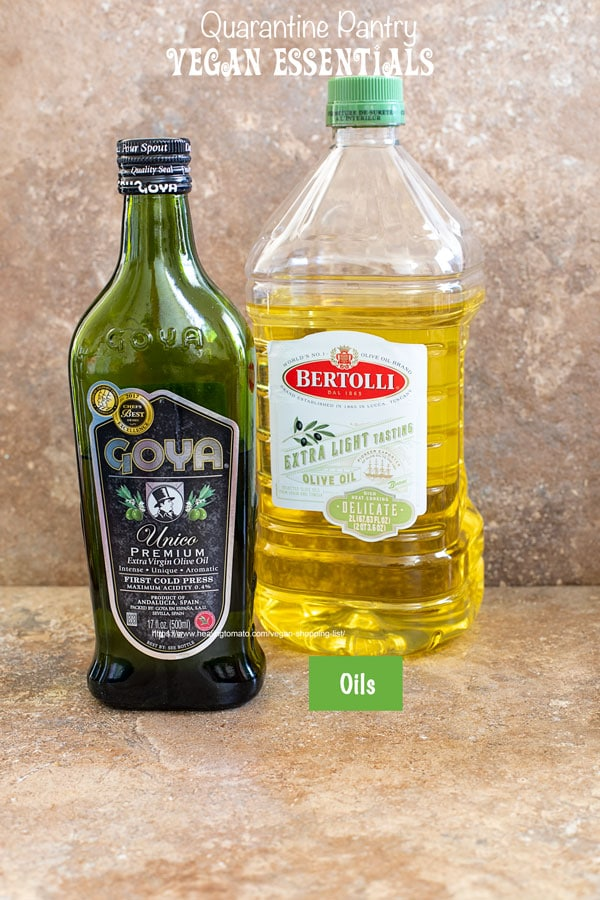 Front view of 2 olive oil bottles