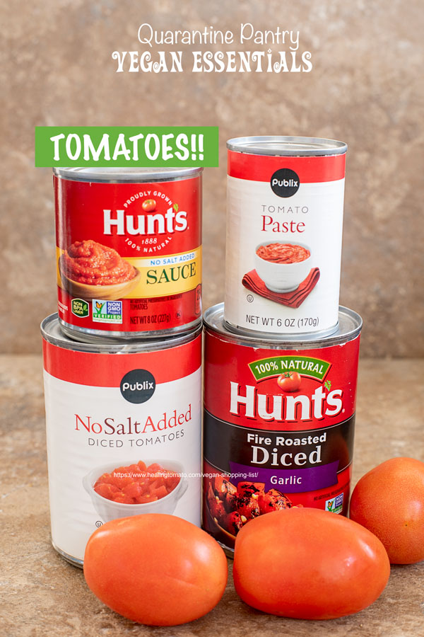 Front view of canned tomatoes and fresh tomatoes for vegan shopping list