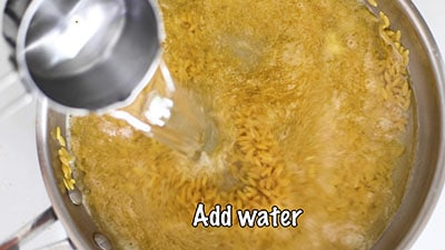 Water being added to the pan