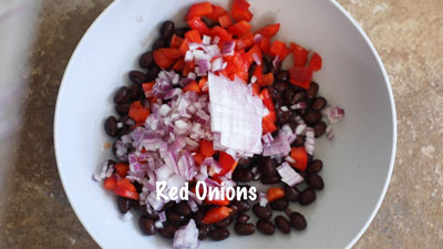 Finely diced red onions added on top of the bell pepper