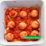 Top view of 1/4 cup of marinara sauce added to the column and rowof meatballs