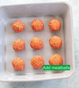 Top view of 9 plant-based meatballs arranged in a 3x3 row/column on grey baking dish