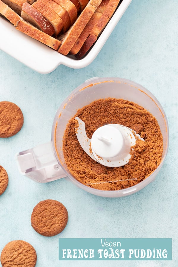 Top view of a small food processor with powdered ginger snaps and whole ginger snaps on the side