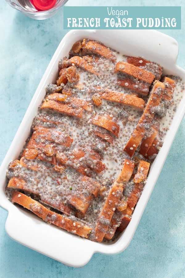 Top view of the chia seeds wet mixture drizzled over the chopped bread in a rectangular baking dish