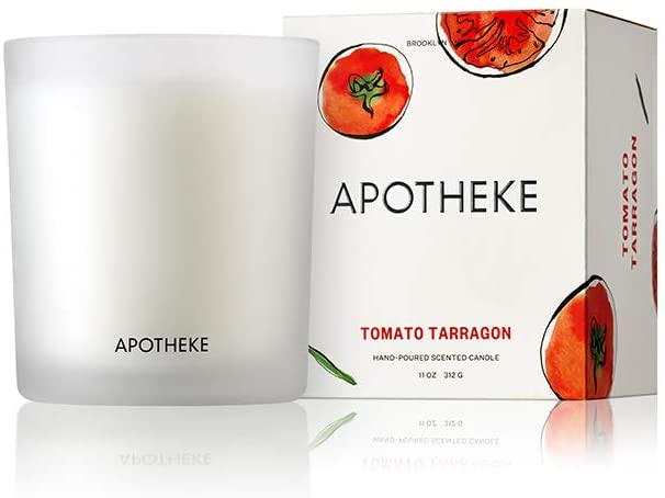 """A small candle with the words """"apotheke"""" on it and an image of the box it comes in."""