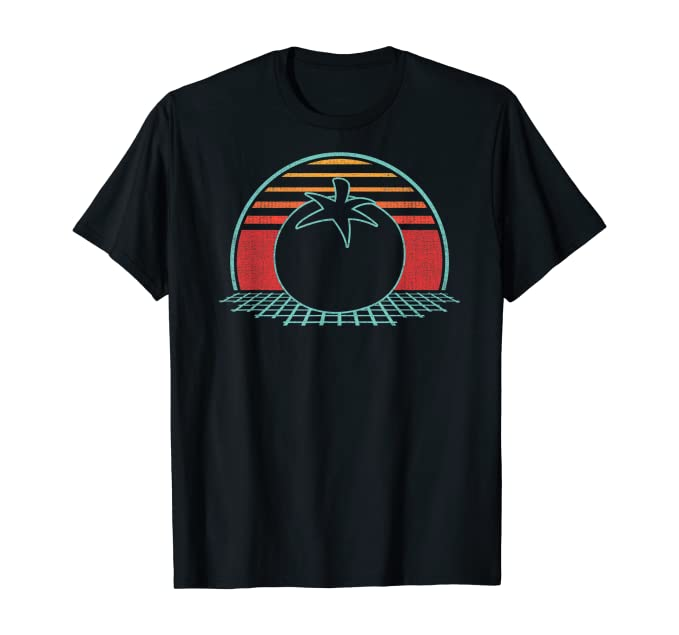 A black t-shirt of a tomato on a grid with a vintage sunrise effect in the background