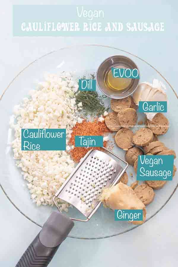 Top view of all 7 ingredients on a clear plate with a grater for the ginger and garlic.