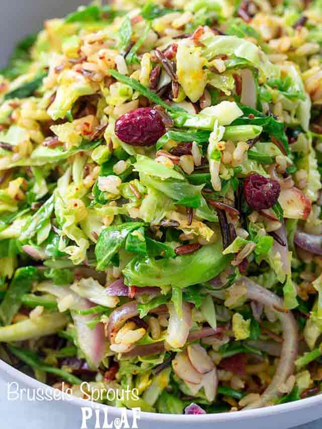 A closeup of a bowl of brussels sprouts pilaf with cranberries, wild rice and almonds