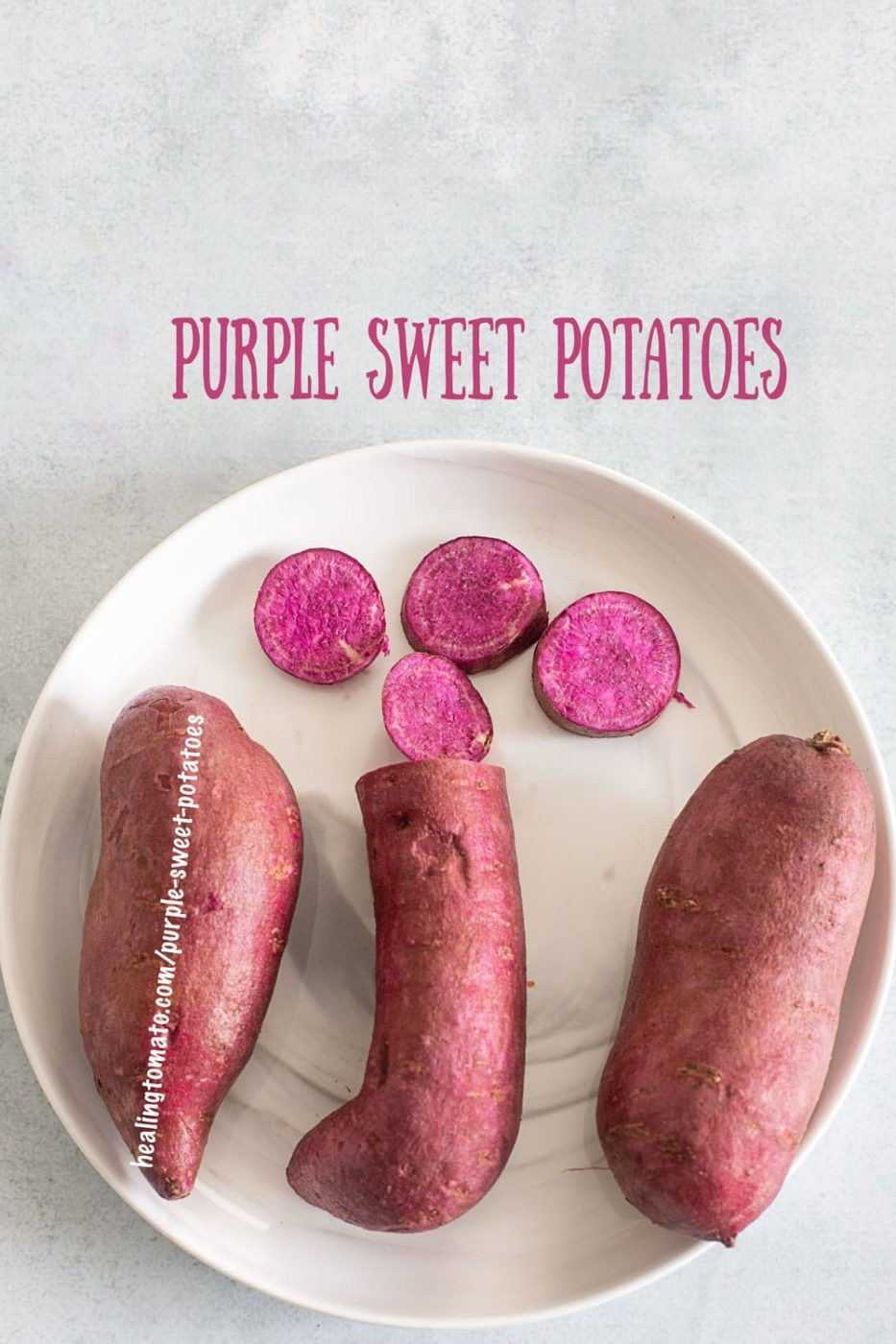 Top view of 3 baby purple sweet potoates with 4 round slices in the middle