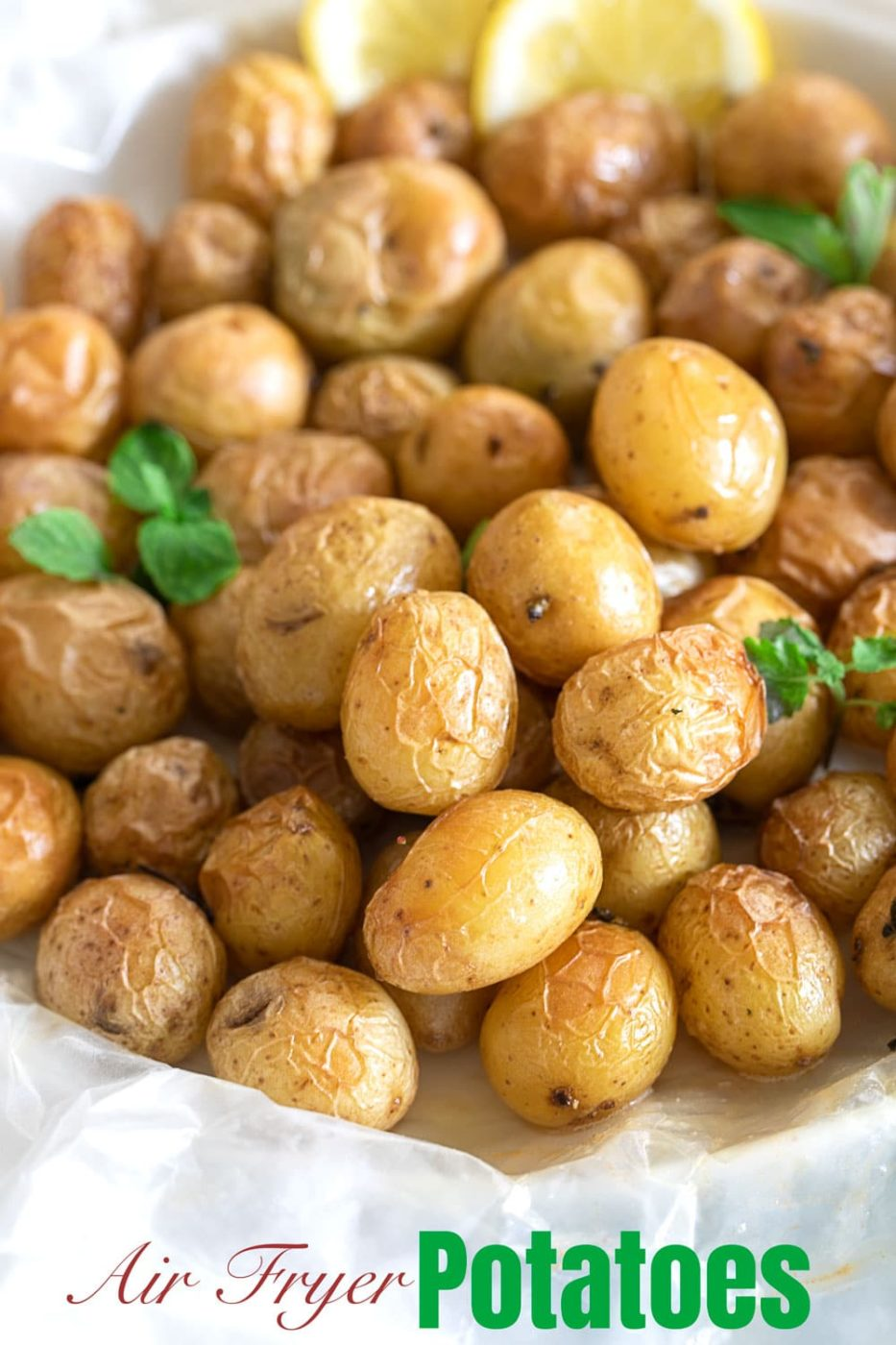 Front view of tiny potatoes in a garlic butter sauce put on a wax paper
