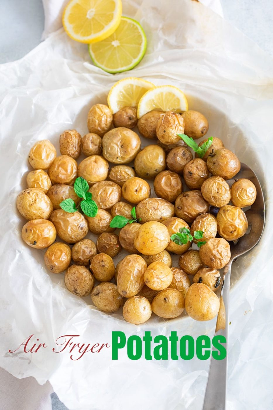 Top view of tiny potatoes in a garlic butter sauce put on a wax paper
