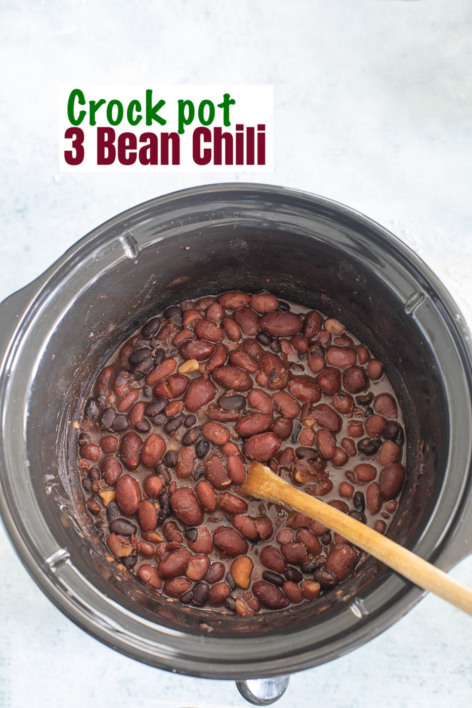 top view of chili inside the ceramic bowl of a crock pot